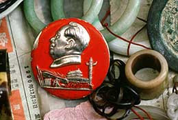 Mao badge from China's Cultural Revolution amid other items at a market in Guangzhou, China.