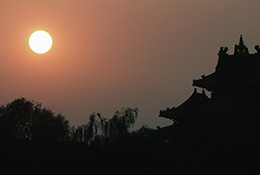 Sunset and a corner tower of the Forbidden City, Beijing, China.