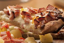 Slice of Canadian bacon pineapple pizza.