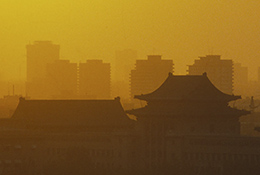 The Forbidden City and high rises amid smog in Bejing, China.