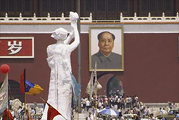 Goddess of democracy statue faces portrait of Mao Zedong at Tiananmen Square, 1989.