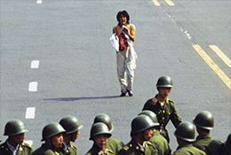 Injured protester and police during the 1989 Tiananmen crackdown in Beijing, China.