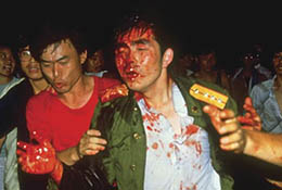 Student protesters helping an injured soldier during Tiananmen crackdown.