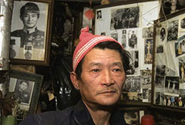 Decorated army veteran in his small shack in Beijing, China, which was slated for demolition.