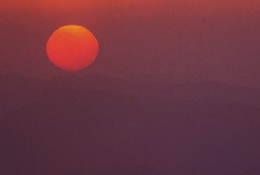 Sunset through pollution in Benxi, China, one of the globe's most polluted cities.