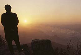 A man looks over the polluted city of Benxi, China.