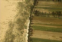The desert pushes against farmland near Yulin, China, in this aerial photo.
