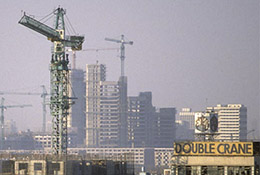 Construction cranes in rapidly developing Beijing, China.