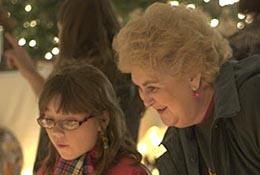 Spectators view an exhibit of Christmas nativity scenes in Apex, North Carolina.
