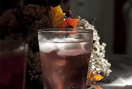 A pink sparkling soda on a holiday table.