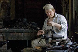 A blacksmith in colonial dress works at Tryon Palace, New Bern, North Carolina.