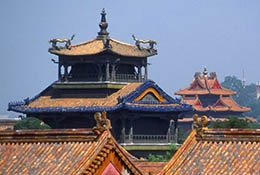 White dagoba and roofs of the Forbidden City, Beijing, China.