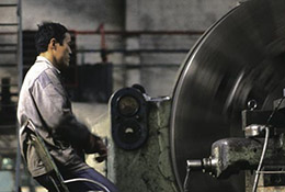 Worker operates a metal lathe at a factory in Taiyuan, China.