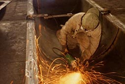 A worker grinds the interior of a large steel structure in Shenyang, China.