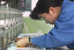 A worker in a machine embroidery factory in Shanghai, China.