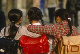 Three school girls in Beijing, China.