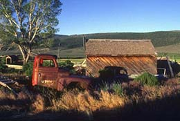Old truck and barn in Koosharem, Utah.