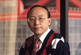 Hong Kong businessman by window.
