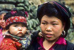 A Chinese minority woman and her child at Peace Village, China.