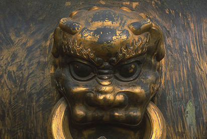 Handle on cauldron at the Forbidden City, Beijing, China.