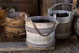 Wooden buckets with wood pile, St. Mary's City, Maryland.